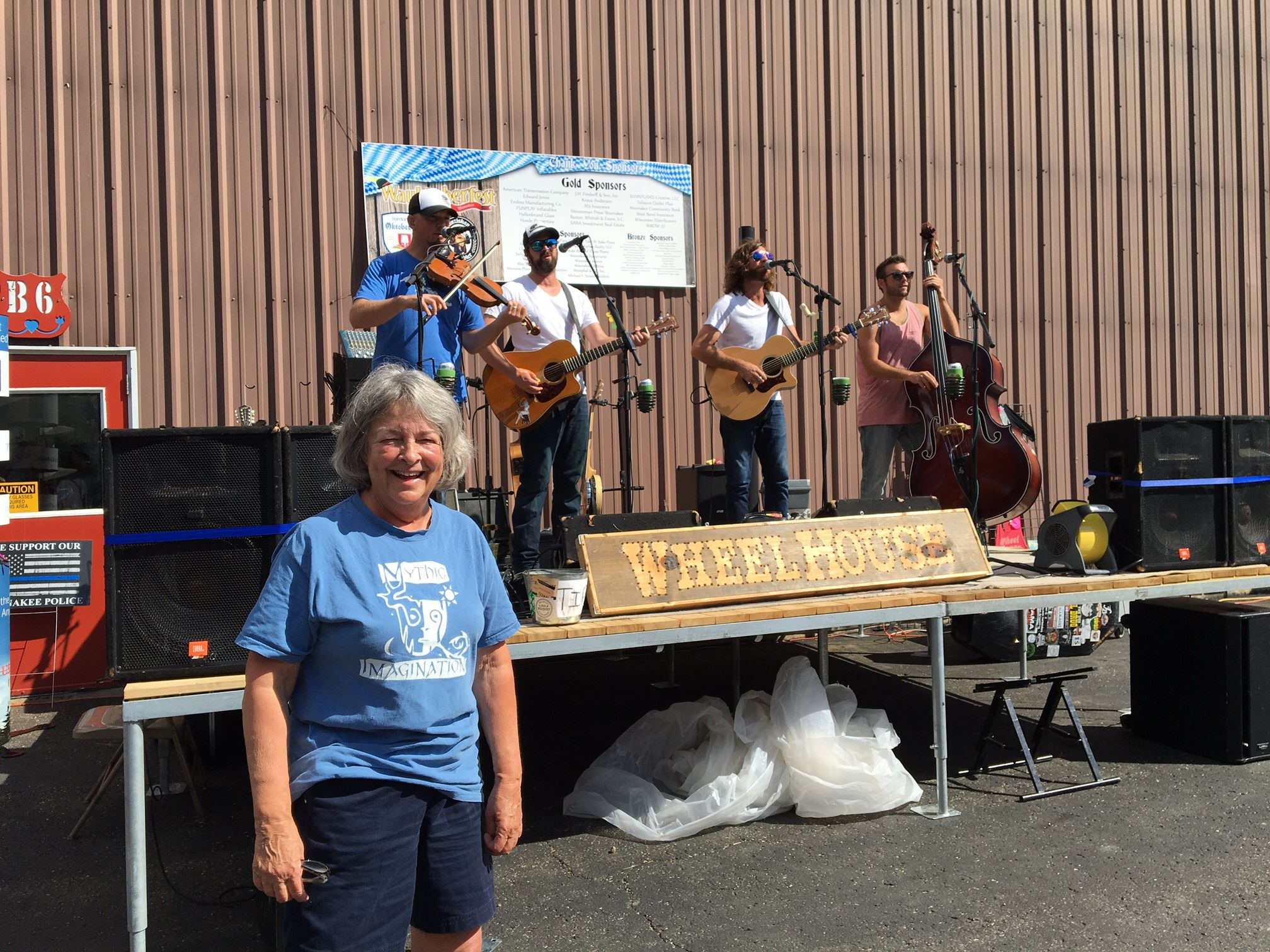 47 Dressed in blue in front of Bluegrass band